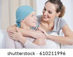 young woman with blue headscarf ... | Shutterstock . vector #610211996