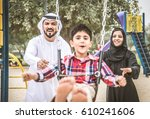 arabic family playing with child | Shutterstock . vector #610241606