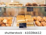 pasties on a display case at... | Shutterstock . vector #610286612