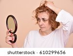 unhappy and dissatisfied middle ... | Shutterstock . vector #610299656