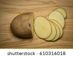Sliced Raw Potato On Wooden...