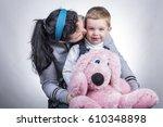 joyful little boy at the hands... | Shutterstock . vector #610348898