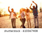 happy young people having fun... | Shutterstock . vector #610367408