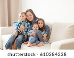 mother with her three children  ...   Shutterstock . vector #610384238