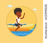 african american tourist riding ... | Shutterstock .eps vector #610390028