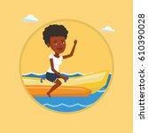 african american tourist riding ... | Shutterstock .eps vector #610390028