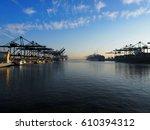 harbor cranes unloading... | Shutterstock . vector #610394312