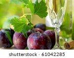 White wine and mature fruits. - stock photo