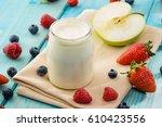 yogurt and fruit | Shutterstock . vector #610423556