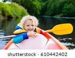 happy kid enjoying kayak ride... | Shutterstock . vector #610442402