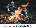 father and son make bonfire in... | Shutterstock . vector #610447826