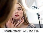 a professional make up artist... | Shutterstock . vector #610455446