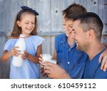 father with children are... | Shutterstock . vector #610459112