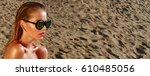tanned girl on the sand in sun... | Shutterstock . vector #610485056
