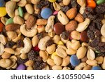 pile of trailmix  nuts  raisins ... | Shutterstock . vector #610550045
