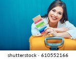 smiling woman holding passport... | Shutterstock . vector #610552166