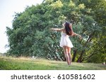 beautiful woman outside at... | Shutterstock . vector #610581602