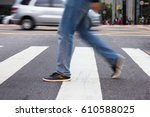 man crossing pedestrian lane....