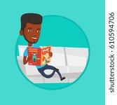 african american man reading a... | Shutterstock .eps vector #610594706