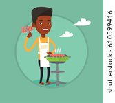 african american man cooking... | Shutterstock .eps vector #610599416