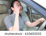 asian woman applying makeup... | Shutterstock . vector #610602032