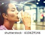 sporty woman drinking coffee in ... | Shutterstock . vector #610629146
