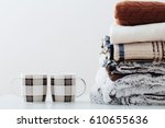 pile of blankets on a white