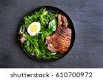 grilled pork steak with green...   Shutterstock . vector #610700972