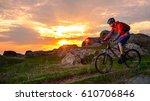 cyclist riding the mountain... | Shutterstock . vector #610706846
