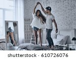 dancing on the bed. full length ... | Shutterstock . vector #610726076