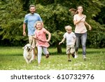 happy children and parents with ... | Shutterstock . vector #610732976