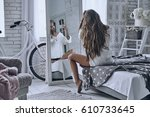 Stock photo taking selfie rear view of beautiful young woman taking self portrait in the mirror using smart 610733645