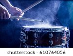 man plays musical percussion... | Shutterstock . vector #610764056