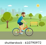 man riding a bicycle in the... | Shutterstock .eps vector #610790972