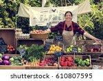 greengrocer selling organic... | Shutterstock . vector #610807595
