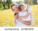 beautiful young mother and her... | Shutterstock . vector #61085458