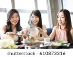 happy young women group  eating ... | Shutterstock . vector #610873316