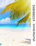 photo of a tropical beach on... | Shutterstock . vector #610884842