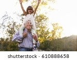 grandfather giving... | Shutterstock . vector #610888658