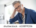 portrait of mature man with... | Shutterstock . vector #610899206