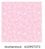 simple floral seamless pattern... | Shutterstock .eps vector #610907372