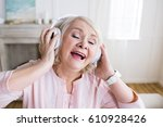 happy senior woman with closed... | Shutterstock . vector #610928426