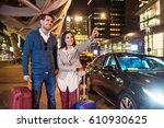 couple with luggage  standing... | Shutterstock . vector #610930625