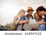 happy friends enjoying... | Shutterstock . vector #610947122