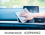 hand cleaning the car interior... | Shutterstock . vector #610964462