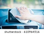 hand cleaning the car interior... | Shutterstock . vector #610964516