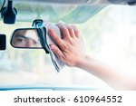 hand cleaning the car interior... | Shutterstock . vector #610964552