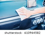 hand cleaning the car interior... | Shutterstock . vector #610964582