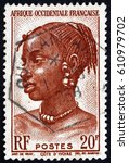Small photo of CROATIA ZAGREB, 5 FEBRUARY 2017: a stamp printed in the France shows Agni Woman, Ivory Coast, circa 1947