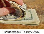 male hand checking and counting ... | Shutterstock . vector #610992932